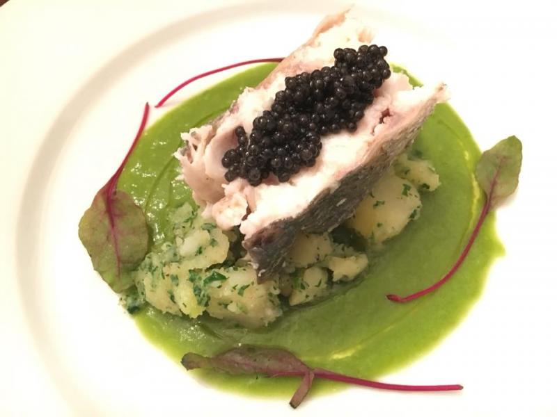 "Steamed ""Branzino, parsley potatoes, warm leek vichyssoise, caviar."