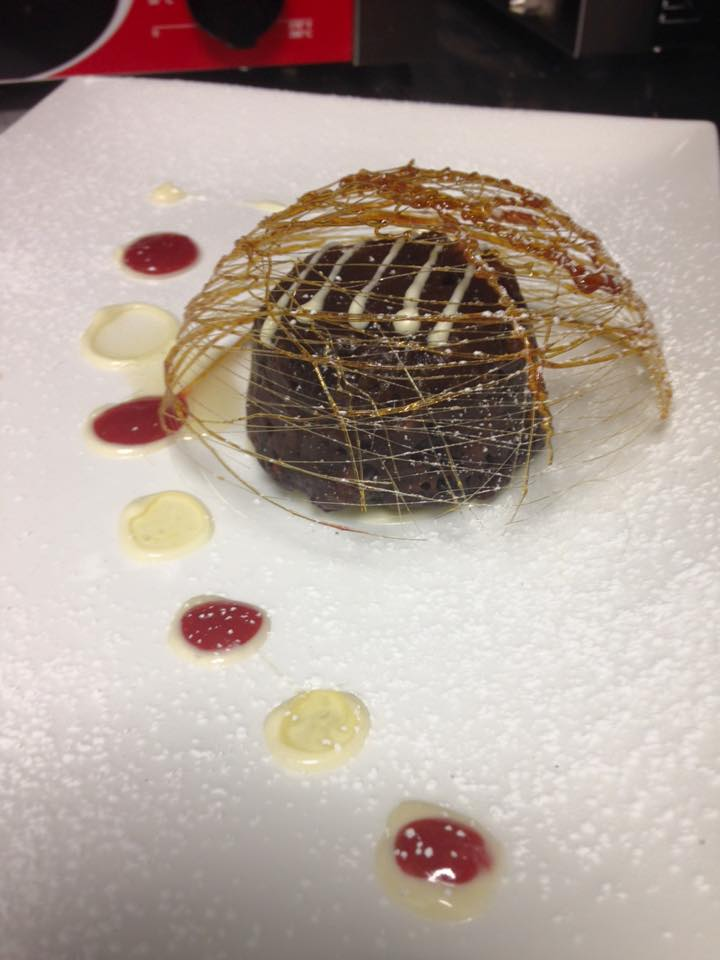 Chocolate bread pudding in a sugar cage