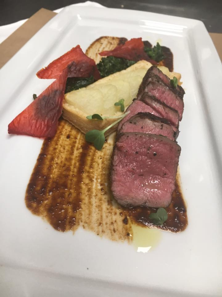 "Grill beef tenderloin ""tagliata"" with baked potato puff pastry gratin, on brushed red wine balsamic sauce, butter spinach and molecular dehydrated red bell pepper leafs."